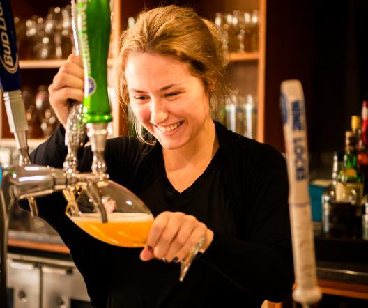 girl pouring beer